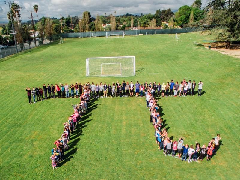 Kindergarten through High School line up to form Pi!